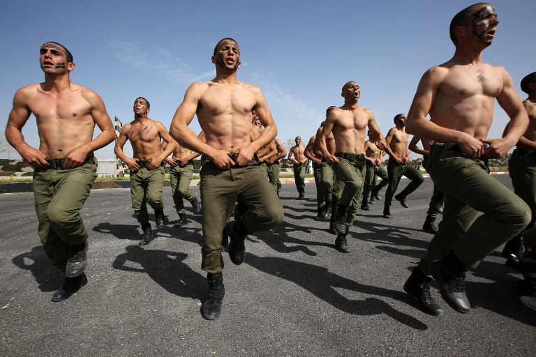 Palestinian men take part in a training session for the presidential guard unit in the West Bank city of Jericho on February 10, 2015. (photo credit: Abbas Momani/AFP)