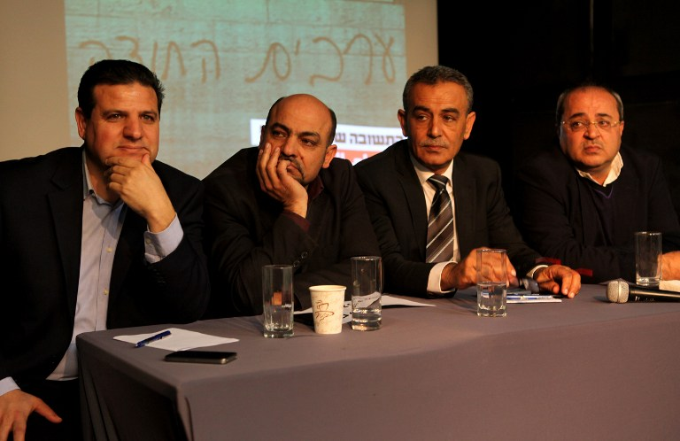 Joint (Arab) List members (from left to right), Ayman Odeh, Masud Ghanayem, Jamal Zahalka and Ahmad Tibi sit together during a press conference in Tel Aviv on February 11, 2015. (photo credit: AFP/GIL COHEN-MAGEN)