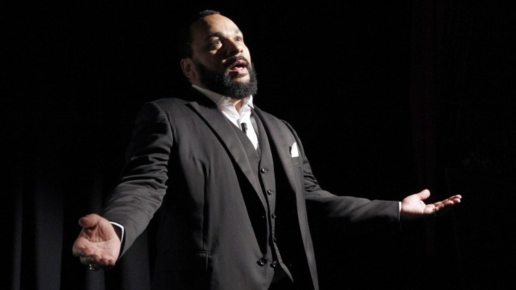 French comedian Dieudonne M'bala M'bala delivering a speech, January 15, 2012. January 15, 2012 shows AFP/PATRICK KOVARIK)
