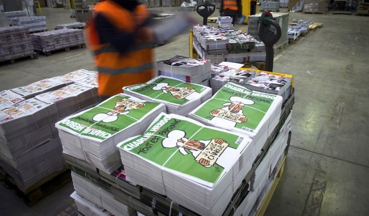 Employees checking the arrival of the then forthcoming edition of the weekly satirical newspaper Charlie Hebdo,   January 13, 2015, Paris, France. (photo credit: AFP/MARTIN BUREAU)