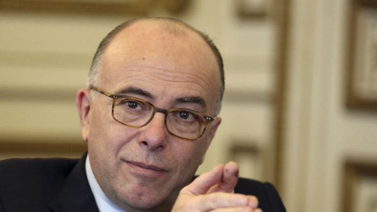 In this photo taken on Monday Feb. 16, 2015, French interior minister Bernard Cazeneuve gestures during an interview with the Associated Press, at his office in Paris. (AP Photo/Remy de la Mauviniere)