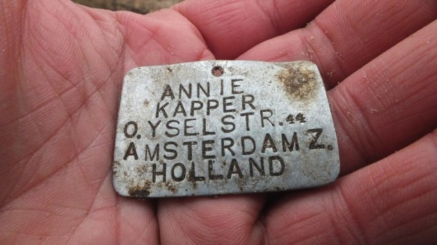 A metal plate bearing the name of 13-year-old Annie Kapper from Amsterdam was found at the Sobibor death camp in eastern Poland in 2013. (Courtesy of Yoram Haimi/JTA)