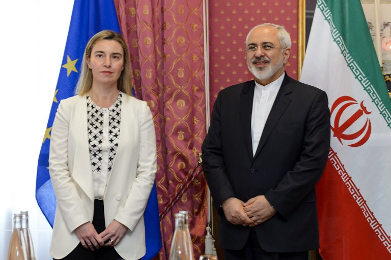 EU foreign policy chief Federica Mogherini (L) meets with Iranian Foreign Minister Mohammad Javad Zarif during Iranian nuclear talks in Lausanne on March 29, 2015. Global powers are seeking to pin down the broad outlines of a deal to rein in Iran's suspect nuclear program by a March 31 deadline. (photo credit: AFP PHOTO / FABRICE COFFRINI)