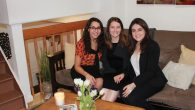 Jessica Levenson, left, Hanna Friedman, Ellie Epstein at the newly opened Upper East Side Moishe House. Hannah Dreyfus/JW