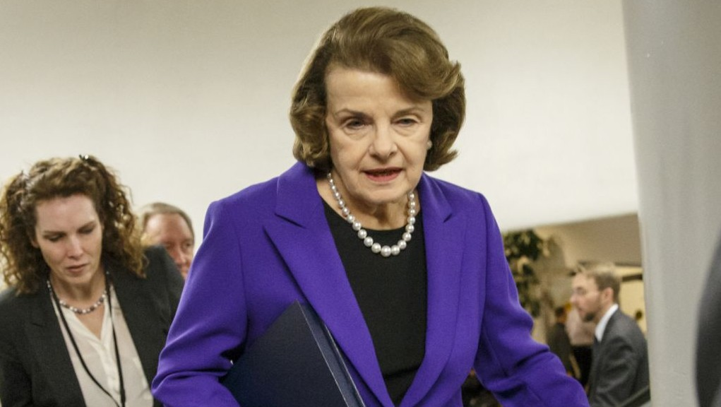 In this Dec. 9, 2014 file photo, Sen. Dianne Feinstein, D-Calif. is pursued by reporters on Capitol Hill in Washington. (photo credit: AP/J. Scott Applewhite)