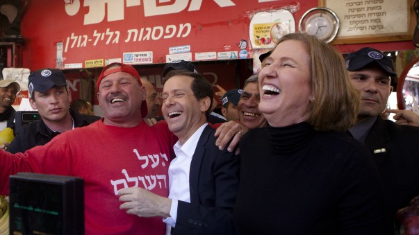 Zionist Union leaders Isaac Herzog (center) and Tzipi Livni (right) during a campaign tour at the Carmel Market in Tel Aviv, March 12, 2015 (photo credit: Amir Levy/Flash90)