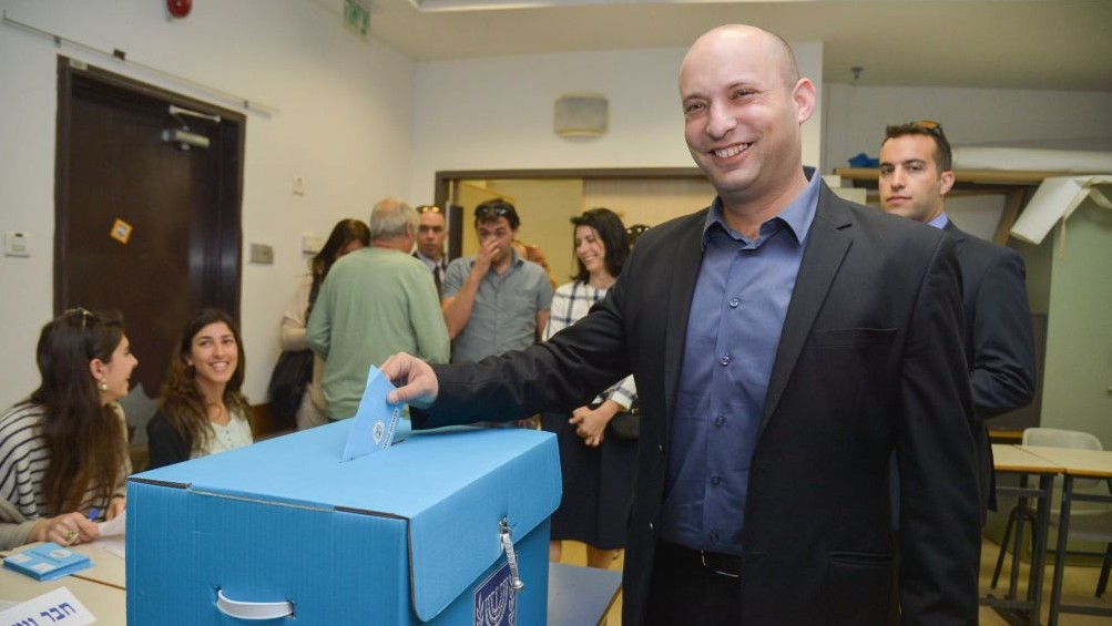 Economy Minister Naftali Bennett, leader of the Jewish Home party, casts his vote in general elections in in Ra'anana, March 17, 2015. (photo credit: Flash90)