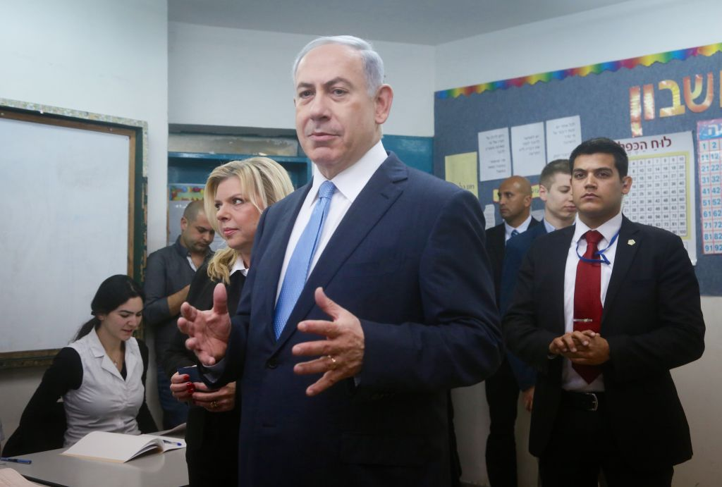 Benjamin Netanyahu and his wife Sara cast their vote at a polling station in Jerusalem on March 17, 2015. (photo credit: Photo by Marc Israel Sellem/POOL/FLASH90)