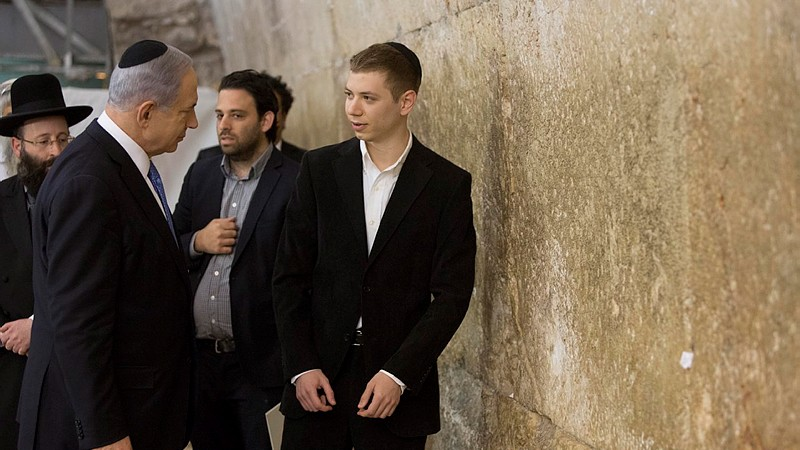 Prime Minister Benjamin Netanyahu and his son Yair visit the Western Wall in Jerusalem's Old City, a day after the elections on March 18, 2015. (Yonatan Sindel/Flash90)