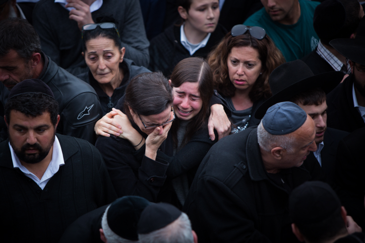 Mourners attend the funeral of the seven children from the Sassoon family in Jerusalem on March 23, 2015. (photo credit: Yonatan Sindel/Flash90)