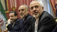 Iranian Foreign Minister Mohammad Javad Zarif (right), waits for the start of a meeting with a US delegation at a hotel in Lausanne, Switzerland, on March 26, 2015. (photo credit: AP/Brendan Smialowski)