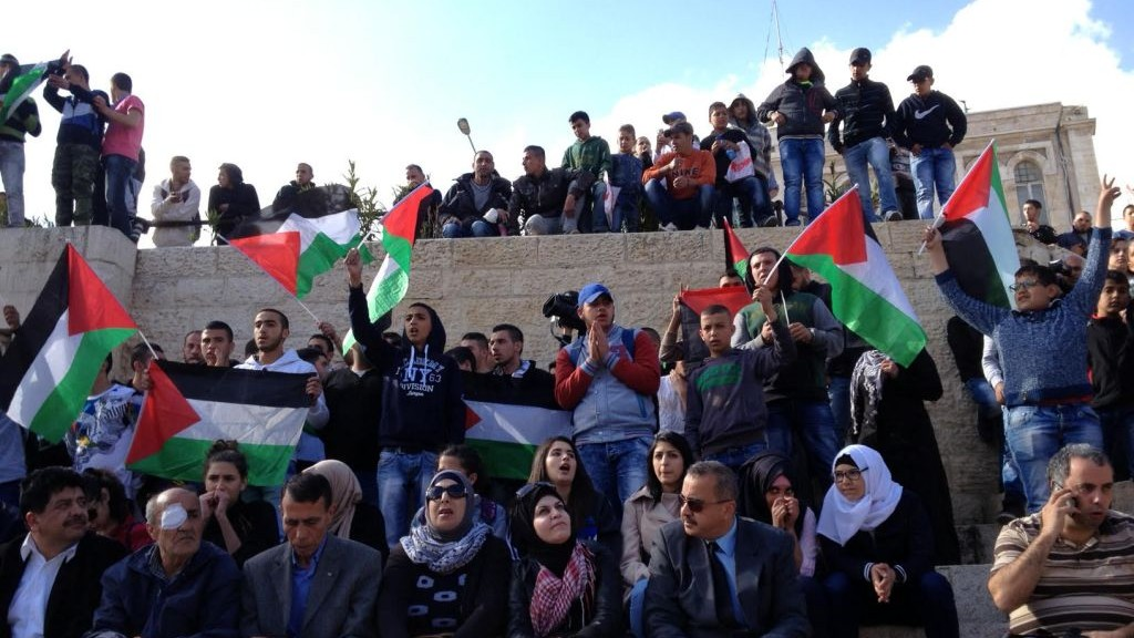 Palestinians singing nationalistic songs near Damascus Gate in the Old City in Jerusalem on Land Day, March 30 2015. (photo credit: Elhanan Miller)