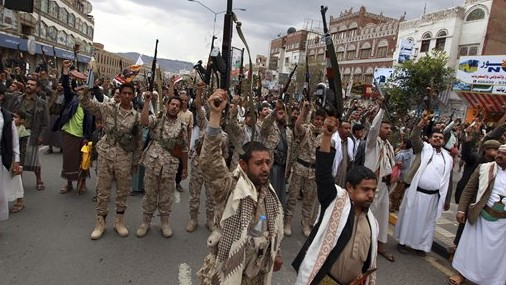 Shiite rebels, known as Houthis, hold up their weapons to protest against Saudi-led airstrikes, as they chant slogans during a rally in Sanaa, Yemen, Thursday, March 26, 2015.  (photo credit: AP Photo/Hani Mohammed)