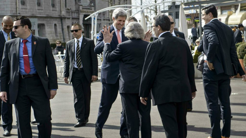 Secretary of State John Kerry greeting Secretary of Energy Ernest Moniz in Switzerland on March 27, 2015, before a round of nuclear talks with Iran that is expected to end in a framework agreement (photo credit: AP Photo/ Brendan Smialowski, pool)