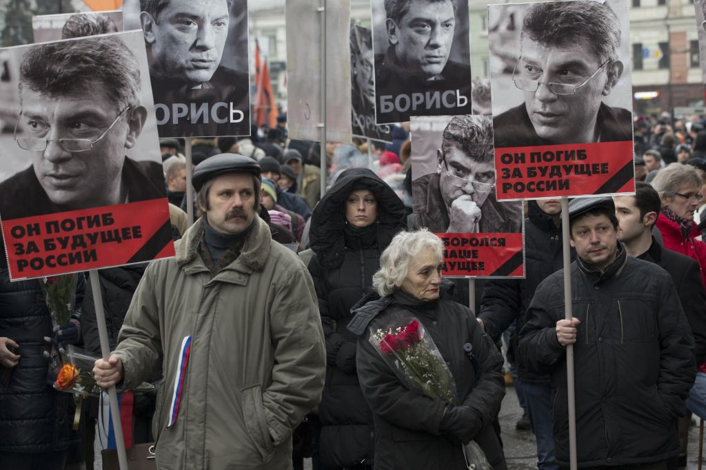 People carry portraits of opposition leader Boris Nemtsov, who was gunned down on Friday, February 27, 2015 near the Kremlin. (photo credit: AP Photo/Pavel Golovkin)