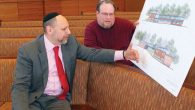 Beth Abraham Rabbi David Holtz and synagogue president Herb Baer look at plans for new Tarrytown building.  Michael Datikash/JW