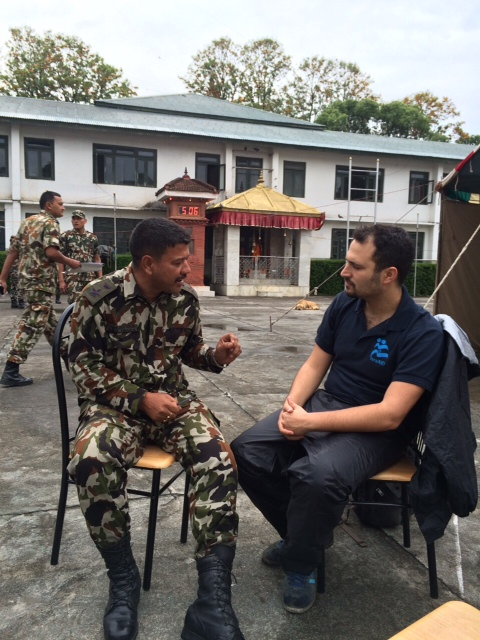Yotam Polizer, IsraAID's Head of Mission and IsraAID Asia Director, speaks with a Nepalese army official, in a picture released by IsraAID on Tuesday, April 28, 2015. (Photo credit: Courtesy IsraAID)
