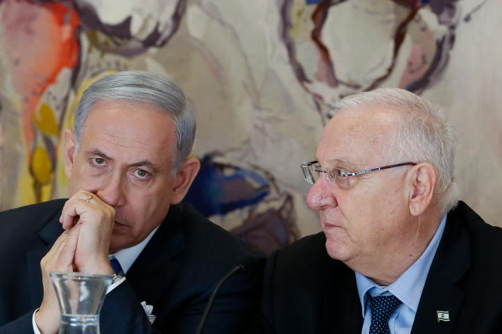 Prime Minister Benjamin Netanyahu (L) seen with President Reuven Rivlin at the opening session of the 20th Israeli parliament, held at the Knesset on March 31, 2015. (photo credit: Miriam Alster/Flash90)