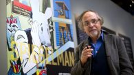Art Spiegelman poses in front of his work at an exhibition in Paris in 2012. Getty Images