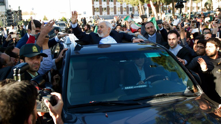 Iranian Foreign Minister Mohammad Javad Zarif (C) greets people as the nuclear negotiating committee arrives at Mehr Abad Airport in Tehran on April 3, 2015, hours after announcing they had the ingredients of a historic nuclear deal with world powers. (photo credit: AFP/ISNA/Borna Ghasemi)
