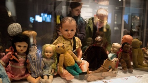 "Dolls and stuffed animals belonging to Jewish children killed in the Holocaust are displayed at ""Children in the Holocaust: Stars Without a Heaven,"" an exhibit at the Yad Vashem Holocaust Memorial Museum in Jerusalem, April 12, 2015. (AFP/Menahem Kahana)"