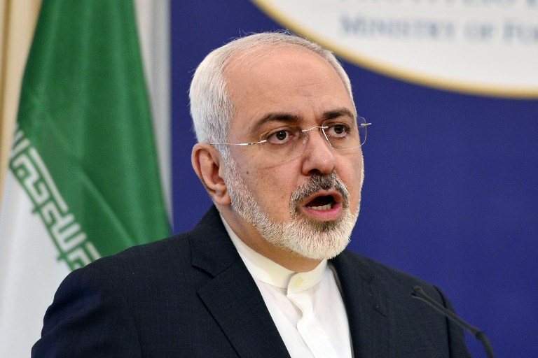 """Iranian Foreign Minister Mohammad Javad Zarif  talks to the press  at the Foreign Ministry in Athens, on May 28, 2015. Iran warned global powers against making """"excessive demands"""" in talks aimed at sealing a ground-breaking nuclear deal, after France demanded access to its military installations.  (AFP PHOTO / LOUISA GOULIAMAKI)"""