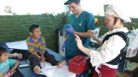 Medical clown Smadar Harpats gets a smile from an injured Nepalese boy at IDF field hospital. Photos By Nathan Jeffay/JW