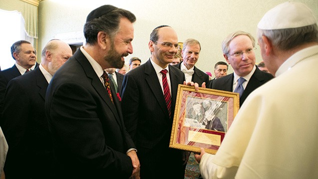 Rabbi Noam Marans, center, stands with a group of AJC representatives as they present Pope Francis with the photos of Rabbi Heschel and Cardinal Bea in 2013.