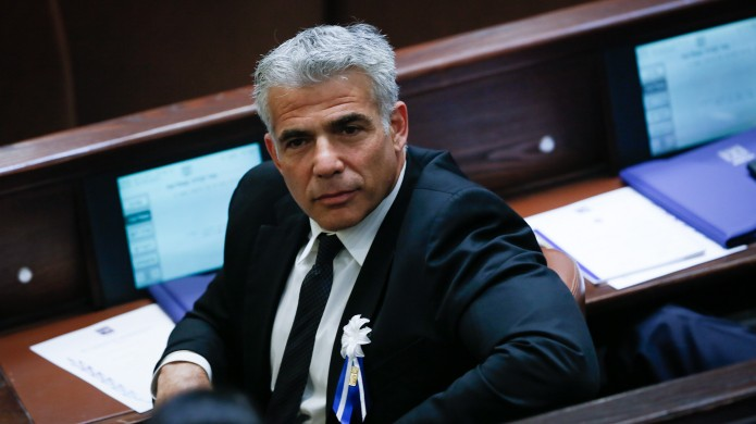 Yesh Atid party leader Yair Lapid seen during a swearing in ceremony for the 20th Knesset on March 31, 2015 (Miriam Alster/Flash90)