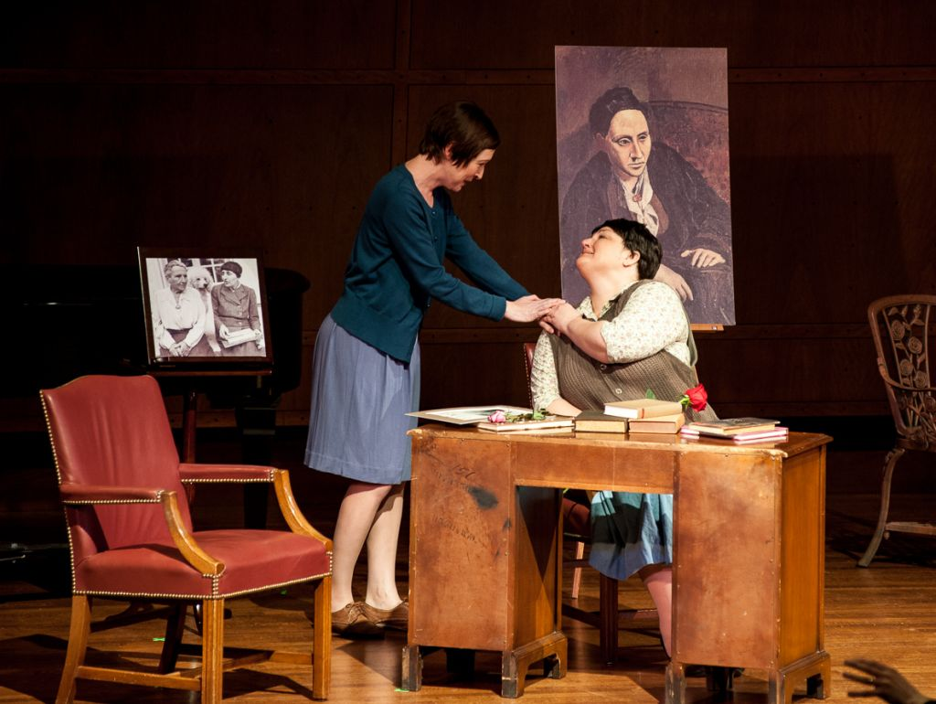 A young orphan, played by soprano Ava Pine, shares a moment with Gertrude Stein, played by mezzo Catherine Cook (Courtesy of Michael Beaton)