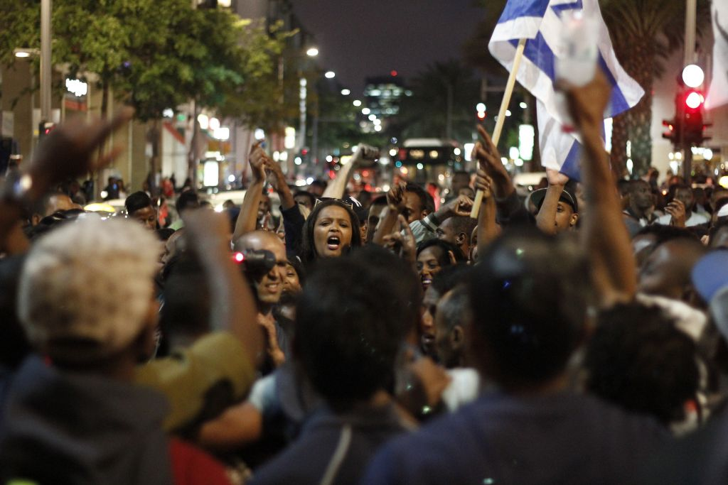 Ethiopian Israelis march in an anti-police brutality demonstration in Tel Aviv's Rabin Square on Sunday, May 3, 2015. (photo credit: Judah Ari Gross/Times of Israel staff)