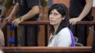 Palestinian Parliament member Khalida Jarrar of the Popular Front for the Liberation of Palestine (PFLP) attends a court session at the Israeli Ofer military base near the West Bank city of Ramallah, Thursday, May 21, 2015 (AP Photo/Majdi Mohammed)