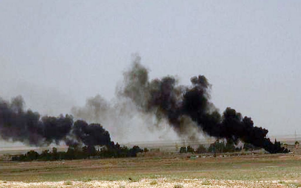Black columns of smoke rise through the air during a battle between Islamic State militants and Syrian government forces on a road between Homs and Palmyra, Syria in this picture published Wednesday, May 21, 2015 (the website of Islamic State militants via AP)
