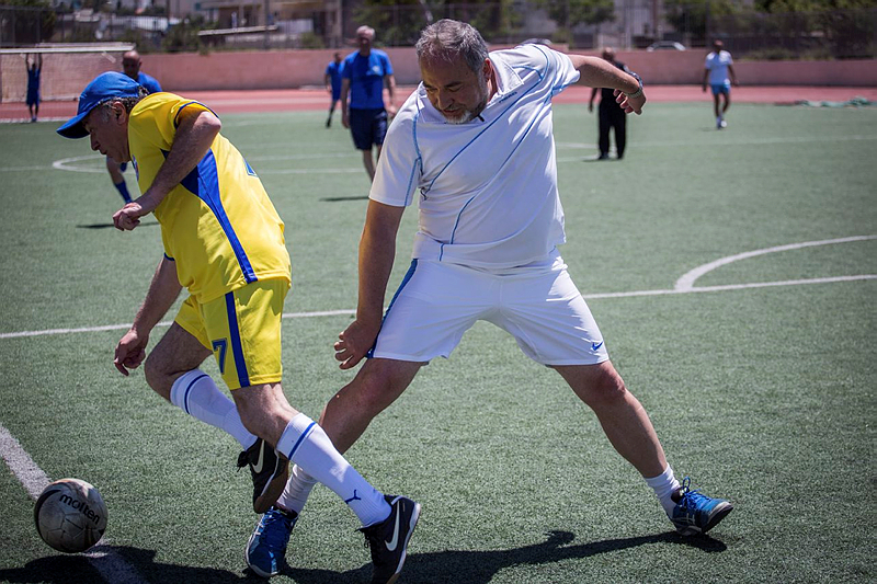 Israeli Beytenu party leader, Avigdor Liberman, and his party members play soccer in Jerusalem against a team of the Russian Jewish Congress members, marking the victory day on Nazi Germany, 70 years ago, May 7, 2015. (Photo credit: Hadas Parush/Flash90)