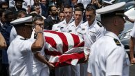 Midshipmen from the U.S Naval Academy carry Midshipman Justin Zemser to a waiting car after his funeral on May 15, 2015. JTA.
