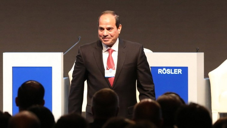Egyptian President Abdel Fattah el-Sissi stands on stage on the opening day of the World Economic Forum on the Middle East and North Africa 2015 on May 22, 2015 in the Dead Sea resort of Shuneh, Jordan. (AFP/Khalil Mazraawi)