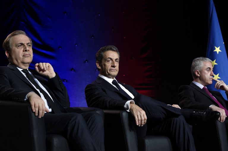 Nicolas Sarkozy (C) attends a meeting in Asnieres-sur-Seine, in the northwestern suburbs of Paris, on June 3, 2015, flanked by French Senator Roger Karoutchi (L) and Manuel Aeschlimann, the Les Republicains party mayoral candidate in Asnieres-sur-Seine. (AFP PHOTO / LIONEL BONAVENTURE)