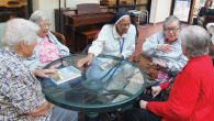 Sister Loretta Theresa Richards, in nun's habit, talks with Jewish Home Lifecare residents and Sister Margaret Smith, left.