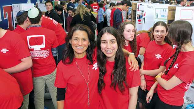 Frisch students, wearing red T-shirts, presented innovations and observed the work of their fellow students.
