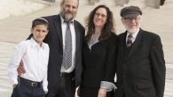 Menachem Zivotofsky, left, with his father Ari, second from left, and attorneys Aliza Lewin and Nat Lewin.  JTA