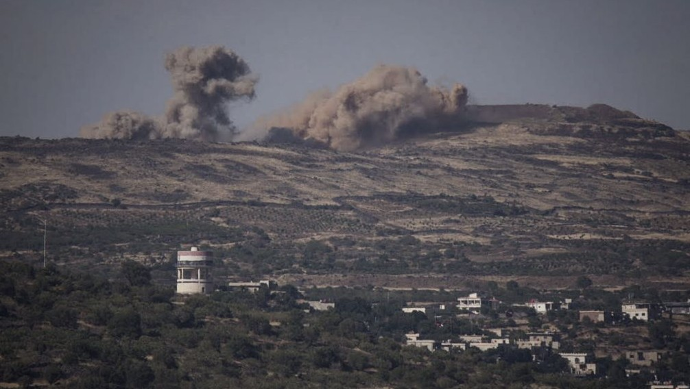 Explosions from the fighting in Syria seen from the Israeli side of the border on the Golan Heights due, June 16, 2015. (Basel Awidat/Flash90)