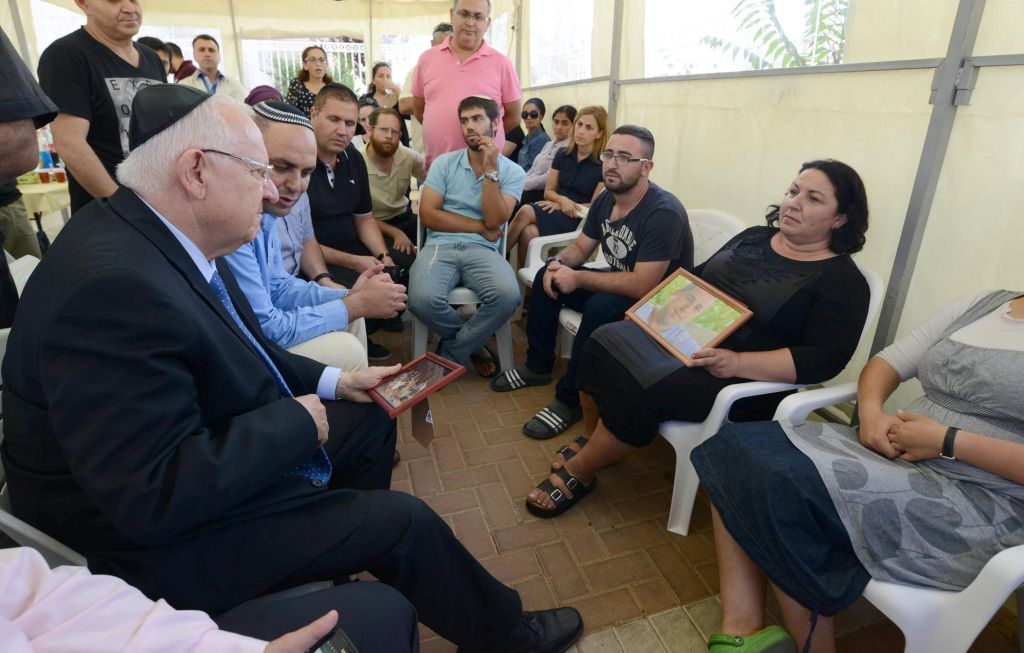 President Reuven Rivlin visits the Gonen family, whose son Danny was murdered in a terror attack on Friday, June 19 2015. Rivlin visited the family on Monday, June 22. (Mark Neyman/GPO)