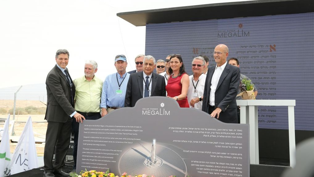 Officials from companies ivested in the Ashalim solar project in the western Negev at a ceremony laying the cornerstone of a solar field, on Thursday, June 11 2015. (Courtesy Moti Yair)