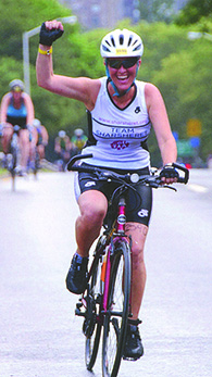 Rochelle Shoretz pumps her fist while competing in the 2012 New York City triathlon. She enjoyed athletic challenges.