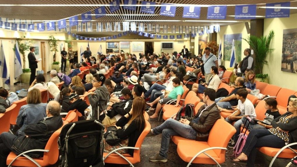 Newly-arrived French Jewish immigrants are briefed upon their arrival at Ben-Gurion International Airport in Tel Aviv, June 29, 2015. (Zed Films)
