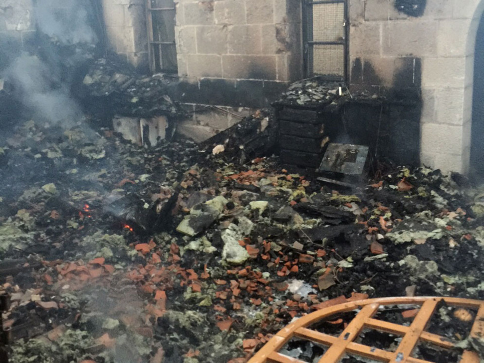 The aftermath of a suspected arson attack at the Church of the Multiplication on the Sea of Galilee on Thursday, June 18, 2015 (Fire and Rescue Services)