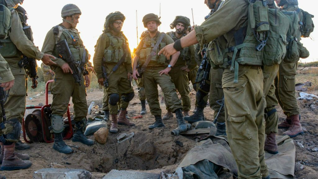 IDF infantrymen congregating around a tunnel entrance in Gaza, July 24, 2014. (Courtesy IDF Flickr)