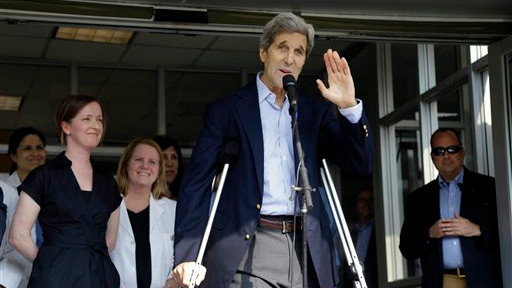 US Secretary of State John Kerry waves after speaking to media as he is discharged from Massachusetts General Hospital Friday, June 12, 2015, in Boston (AP/Elise Amendola)