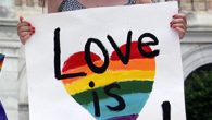 Amy Joslin carried this sign at a rally before the U.S. Supreme Court in June, 2014, a year before the historic decision. RNS