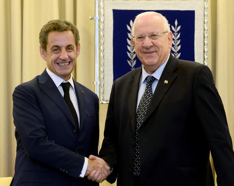 Former French president Nicolas Sarkozy shakes hands with President Reuven Rivlin in Jerusalem June 8 2015. (Mark Neyman/GPO)